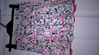 skirts 1 pink  1 patterned age 10-11