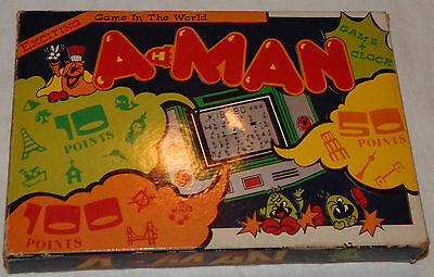*rare Vintage A-Man Lcd Electronic Handheld Game & Clock/watch In Box/boxed/nos*