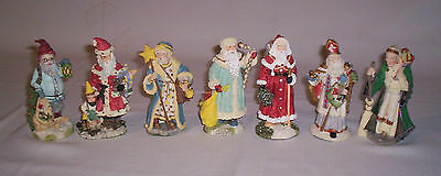 Seven Collectible International Santa Clause Figurines