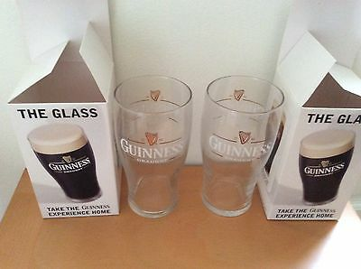Two Guinness 2004 pint glasses in boxes
