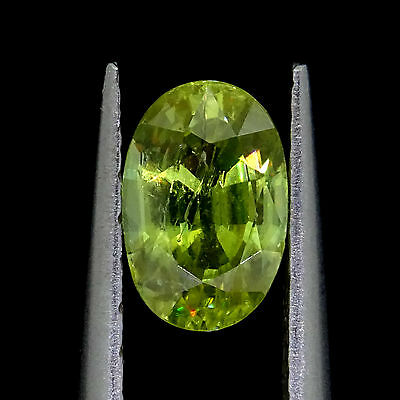 Loose Natural Sphene  0.76ct yellowish green oval cut Loose gemstones