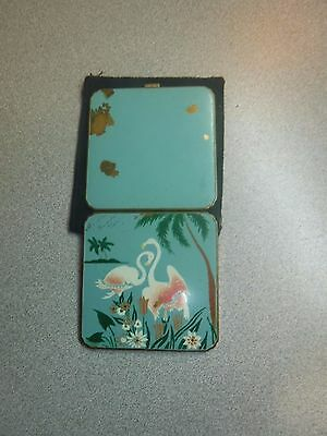 Vintage brass compact with flamingo motif