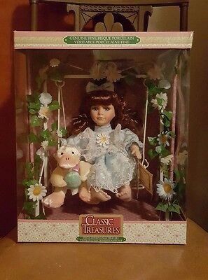 Classic Treasures Bisque Porcelain Doll on Swing