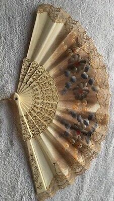 Spanish hand-painted flower pattern, lace-trimmed hand fan.