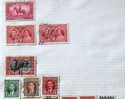 26 x Old Canadian stamps, on an album page