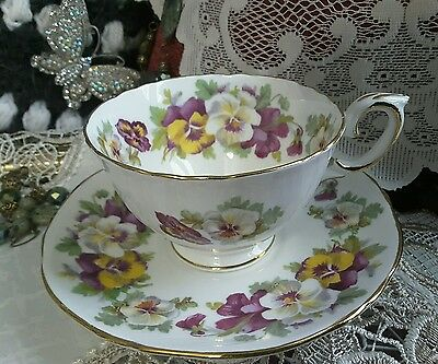 tea cup and saucer STAFFORDSHIRE PANSIES  IN PURPLE WHITE AND YELLOW