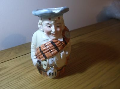 Really lovely Character Jug Scots Man with tartan and white outfit