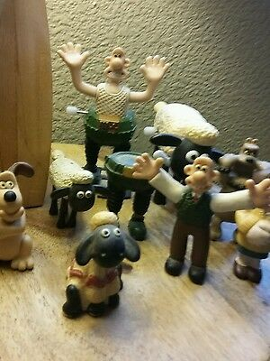 selection of various Wallace and gromit figures .