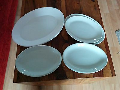 Oval white plates, 6 medium, 2 and 2 larger