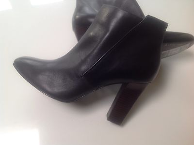 Women's ankle high heeled boots size 8