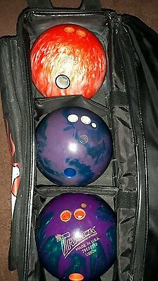 3 ball bowling bag with wheels and 3 fifteen lb bowling balls, small tear in the
