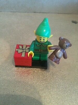 Christmas Lego figure. SANTAS ELF +presents