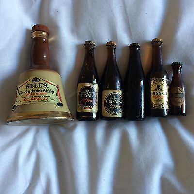 Assorted Miniature Guinness Bottles And One Bells whisky bell