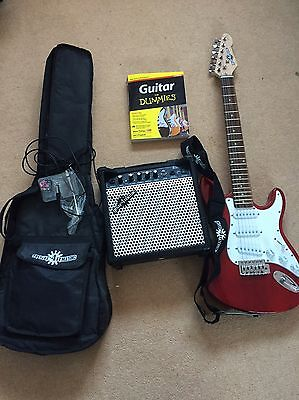 Electric Guitar And Amp With All Cables And Book