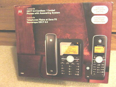 In box MOTOROLA DECT 6.0 1 CORDLESS / 1 CORDED PHONES w/ Answering System