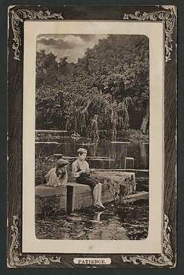 k1887)     EARLY 1900's POSTCARD OF A COUPLE OF KIDS FISHING  (PATIENCE)
