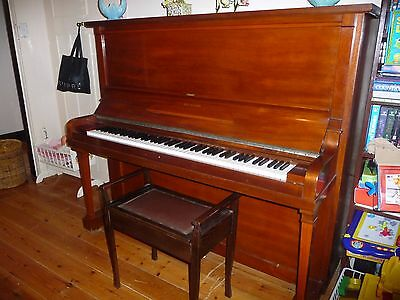 Piano upright in excellent condition, has 2 small marks on top