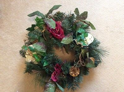 christmas wreath with christmas rose flowers, fir cones & foliage