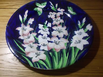 A Rare Maling charger in dark blue print with gladioli and butterfly