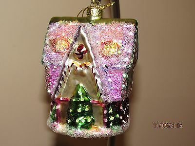 Glass Christmas ornaments.Gingerbread house.