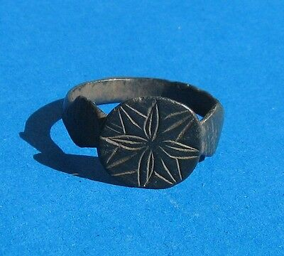 """Ancient bronze finger ring """"Windrose""""."""