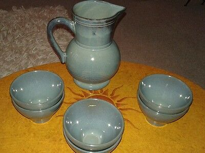 Vintage Emile Henry pitcher and drinking bowls x 6.