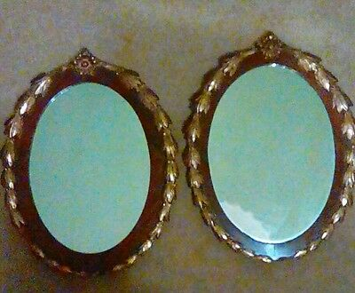 Antique pair of oval gilt and wood mirrors