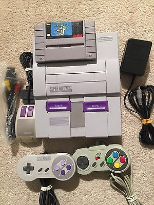 SNES SUPER NINTENDO SYSTEM with hookups controllers and SUPER MARIO WORLD