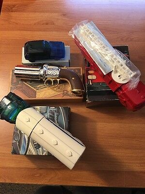 4 Collectible Avon Decanters In Boxes Pepperbox Pistol VW Rabbit & 2 Trucks