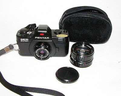 Pentax Auto 110 Super SLR Film Camera with 18mm F2.8 , 50 2,8 Lens and case