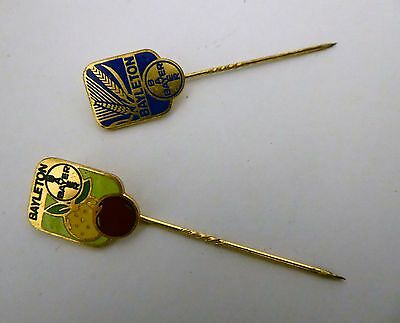 A lot of two vintage BAYER pin badges