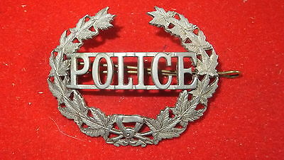 "Police Metal Insignia - Cap Badge-  ""Police"" surrounded by laurel of Maple Leave"