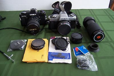 2 Vintage 35mm  Minolta Cameras plus lenses and more