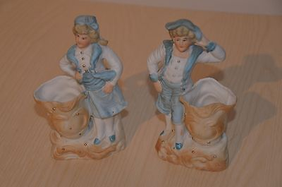 Antique porcelain boy and girl figurines