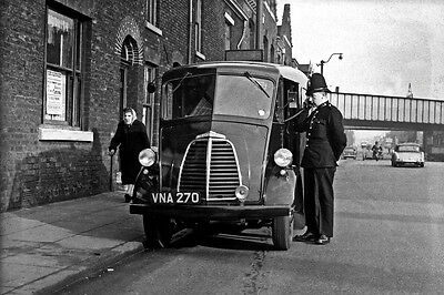 Photo Taken From A 1960's Image - Policeman Using Early Car Radio