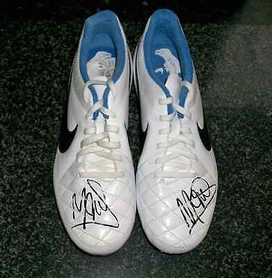 Angel Di Maria hand signed football boots.