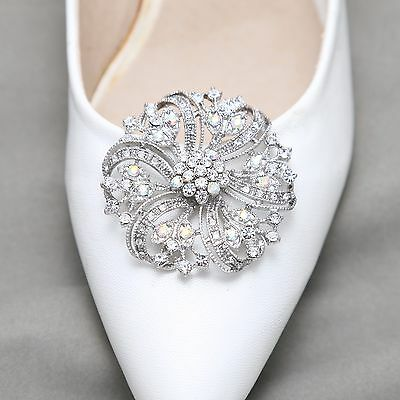 A pair of Rhinestone Crystal Wedding Platform Shoes Winter Boots Shoe Clips