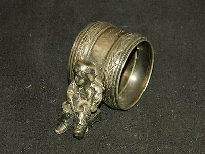 """Antique Silver Plated Figural Napkin Holder Ring """"boy Putting On Boots"""""""