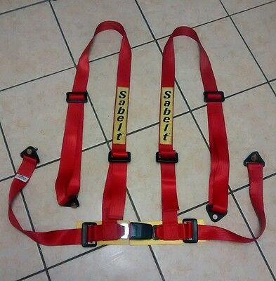 Sabelt 4 point harness in red.