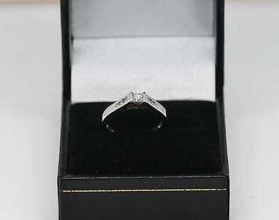 18ct diamond solitaire with diamond shoulders engagement ring
