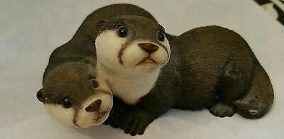 Otters Oakwood sculpture Made in England