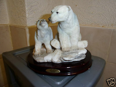 two polar bears on wooden stand