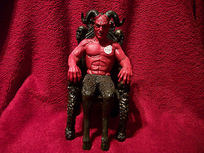 Devil on a chair statue