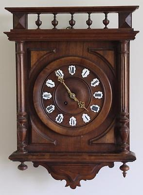 A C19th French Carved Walnut Cased Wall Clock Chiming on a Gong