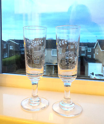 A Pair of Etched Crystal Champagne Flutes