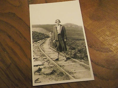 Vintage Real Photo Postcard Of Lady Hiking On What Looks Like An Old Ralway Line