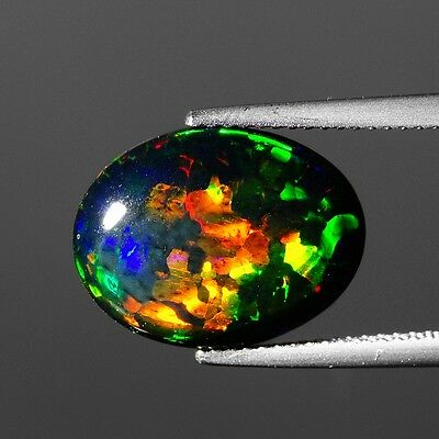 Fine Luster 4.29 cts Black Opal Multicolor Rainbow Natural Oval Shape F646