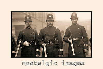 PHOTO TAKEN FROM A 1911 image OF ARMED POLICE AT THE SYDNEY ST SIEGE  1911