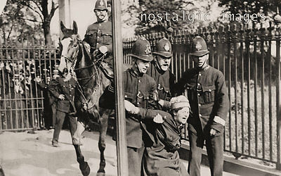 Photo Taken From A 1910 Image Of Police Officers Arresting A Suffragette