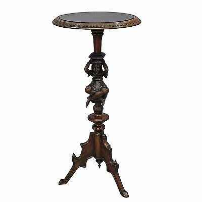 a great antique guéridon with jester base, black forest ca. 1900